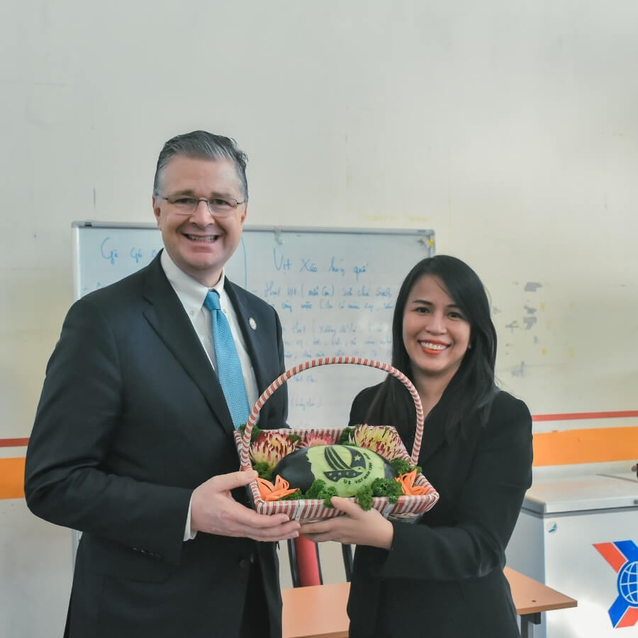 Mr. Krintenbrink and Ms. Tam REACH's Executive Director